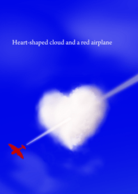 Heart-shaped cloud and a red airplane